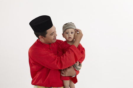 malay family ,father and son Imagens