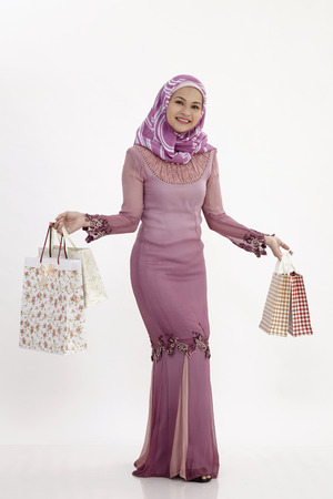 malay woman shopping on the white background