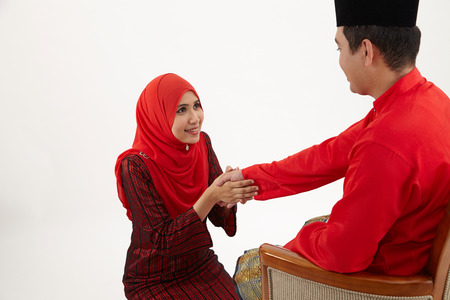 wife greeting or salam to husband during hari raya