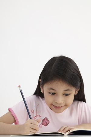 little girl writting doing homework 版權商用圖片