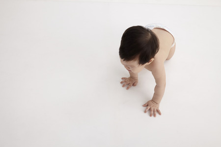top view of chinese baby girl crawling Stock Photo