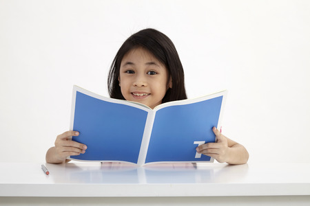 little reading textbook on the white background