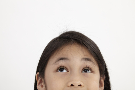 close up of the litlle girl looking upward