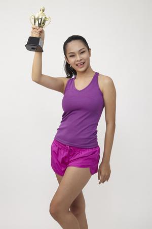 chinese woman holding a golden trophy 免版税图像
