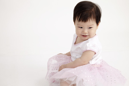 portrait of chinese baby girl looking down