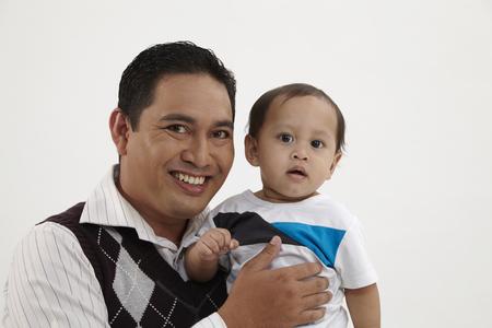 malay family man arms around his child