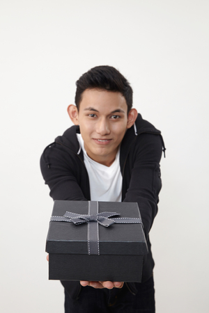 man holding an exclusive present