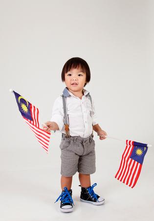 chinese boy holding malaysia flag
