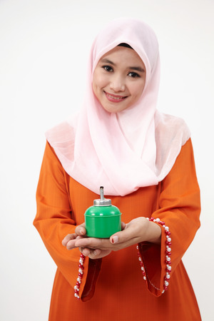 Asian Muslim Malay woman with tudung over white background Stock Photo