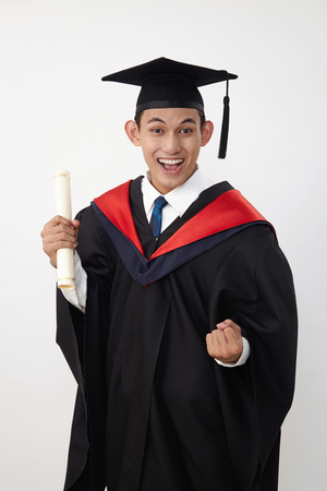 young malay teenage graduated student wear rope holding certificate