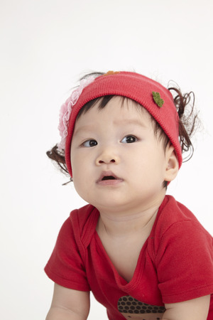 close up of the chinese baby with red hair band Stockfoto