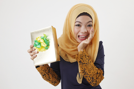 malay woman with tudung excited received a gift