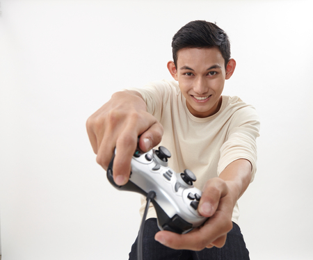 malay teenage holding game console playing