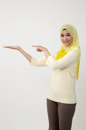 malay woman showing and point with hand gesture