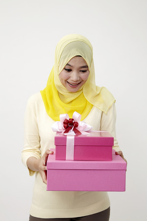 woman holding a pink color present box