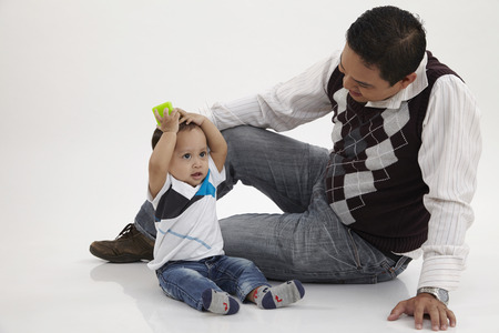 malay family man playing with his child