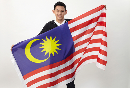 young malay teenage holding malaysia flag
