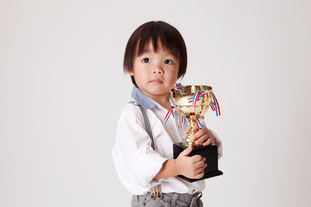 chinese boy with gold trophy Banco de Imagens