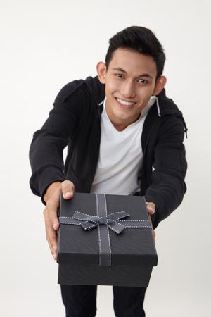 man holding an exclusive present Reklamní fotografie