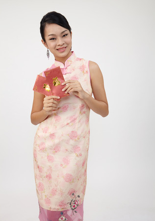 chinese young woman holding ang paw for happy chinese new year Zdjęcie Seryjne