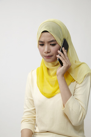 malay woman on the line with sad expression