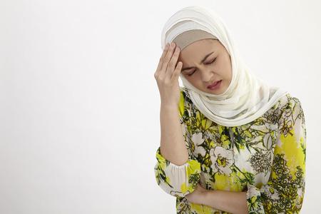 Malay woman suffering from a terrible headache 写真素材