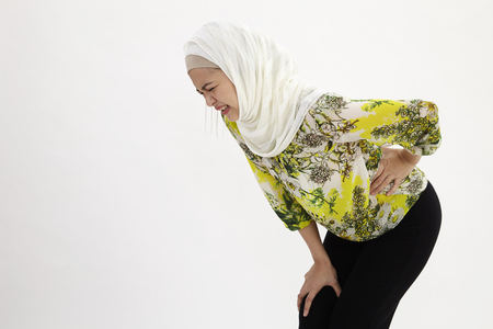 malay woman having back pain 版權商用圖片