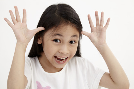 girl making funny face on the white background