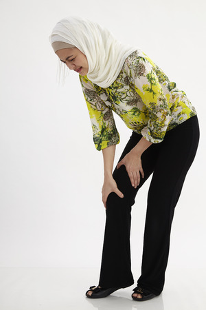 malay woman suffering with leg pain