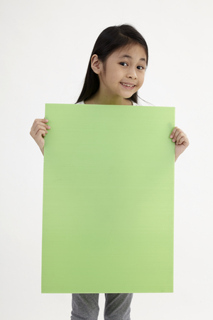 kid holding placard on the white background Stock Photo