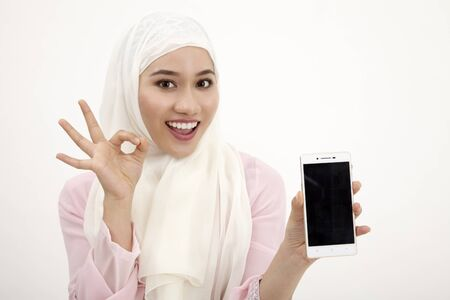 portrait of malay woman holding phone