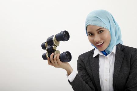 malay business woman holding binocullars