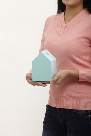 midsection of woman holding a model house Stock Photo