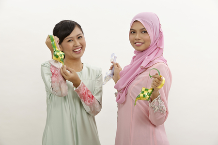 two malay women holding decoration ribbon ketupat Stock fotó