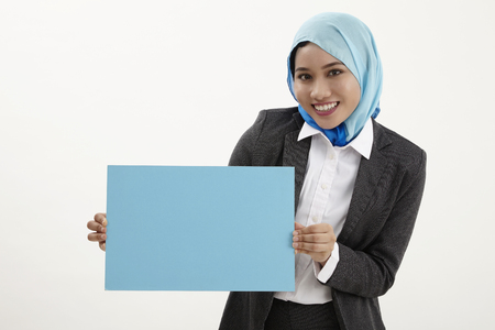 malay business woman with tudung holding a placard