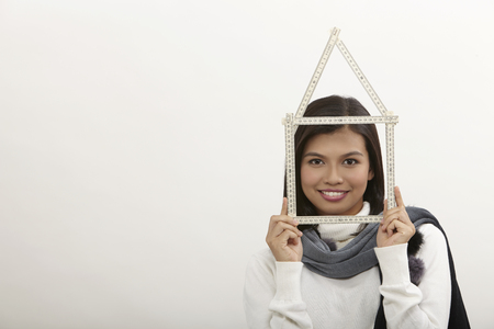 malay  woman looking through the house frame, over white background Imagens - 119349443