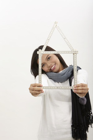 malay  woman looking through the house frame, over white background Standard-Bild - 119369298