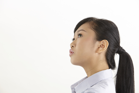 side view of the asian woman on the white background