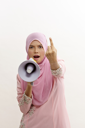 malay woman speaking into a megaphone making a public announcement isolated on white