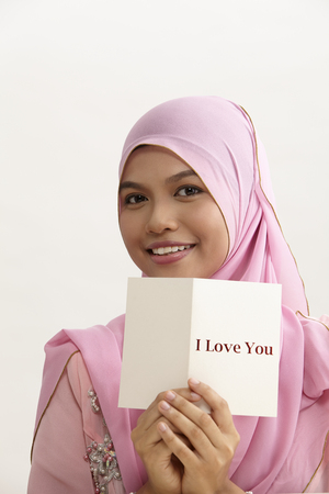 malay woman with tudung holding i love you greeting card
