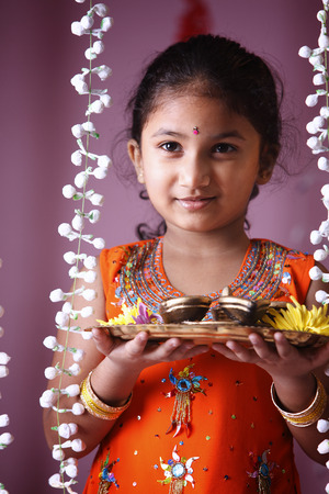 Little Indian girl holding oil lamp 写真素材