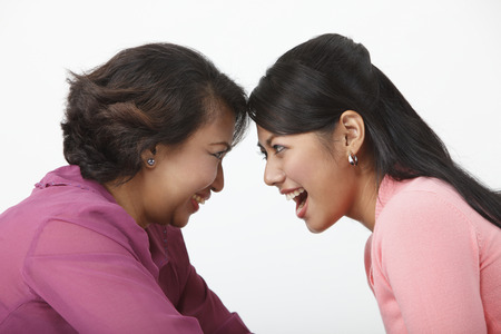 Close up of mother and daughter looking at each other 版權商用圖片