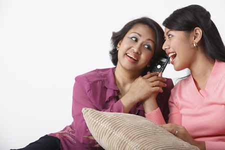 Mother and daughter listening to phone