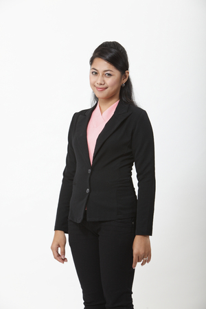 Young woman in black jacket posing to camera Stock Photo