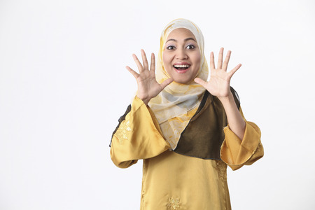 Malay woman with a surprised expression. 스톡 콘텐츠