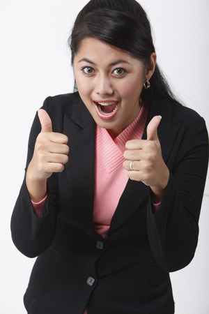 Close up of young woman with both thumbs up