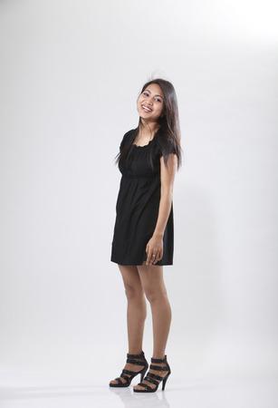 Sexy slim fashion model posing for studio shot
