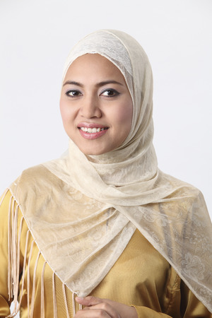 Malay woman with her arms folded.