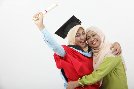 Young woman with her mother on graduation day