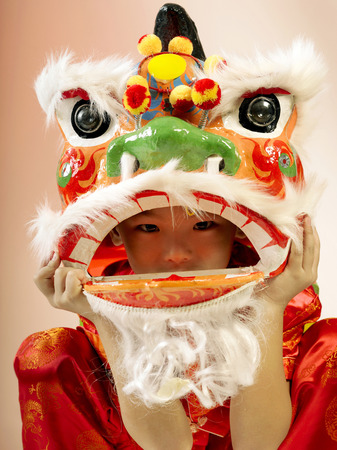 A boy playing lion dance looking at the camera Stock Photo - 125011123